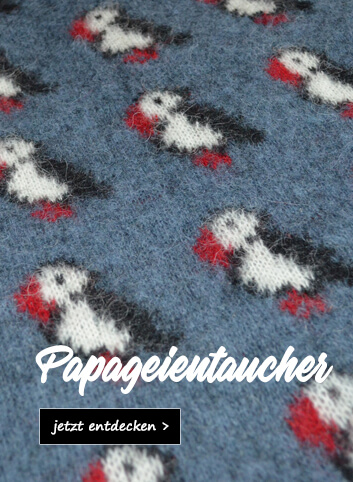 Strickwaren mit Papageientaucher-Motiv